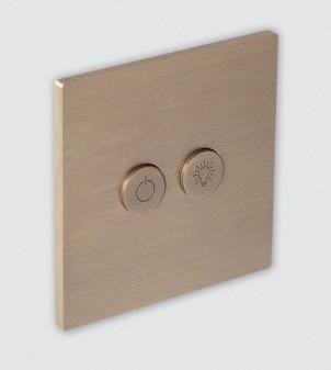 Placas eléctricas en latón con botones redondos